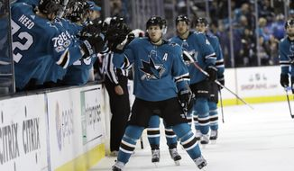 San Jose Sharks' Logan Couture, center, celebrates with teammates after scoring a goal against the Ottawa Senators during the first period of an NHL hockey game Saturday, Dec. 9, 2017, in San Jose, Calif. (AP Photo/Marcio Jose Sanchez)