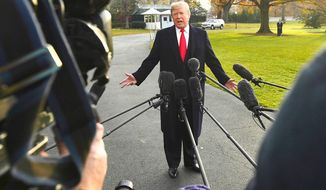 President Trump during a recent encounter with reporters on the South Lawn of the White House, surrounded by microphones and cameras. (Associated Press)