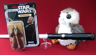 Gift ideas for 'Star Wars' fans include Hasbro's 40th Anniversary Ben (Obi-Wan) Kenobi, Seven 20's Porg and UltraSabers' Dark Prophecy saber. (Photograph by Joseph Szadkowski / The Washington Times)