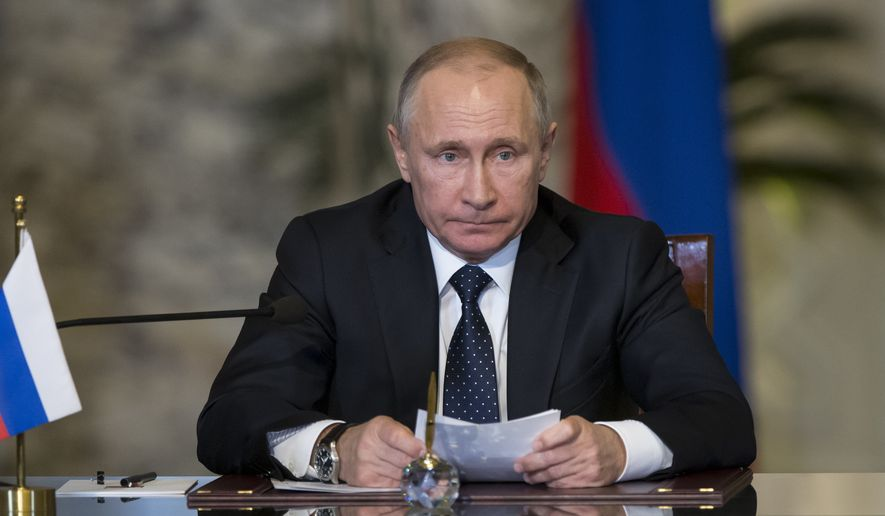 Russian President Vladimir Putin speaks during his and Egyptian President Abdel-Fattah El-Sissi news conference following their talks in Cairo, Egypt, Monday, Dec. 11, 2017. (AP Photo/Alexander Zemlianichenko, pool)