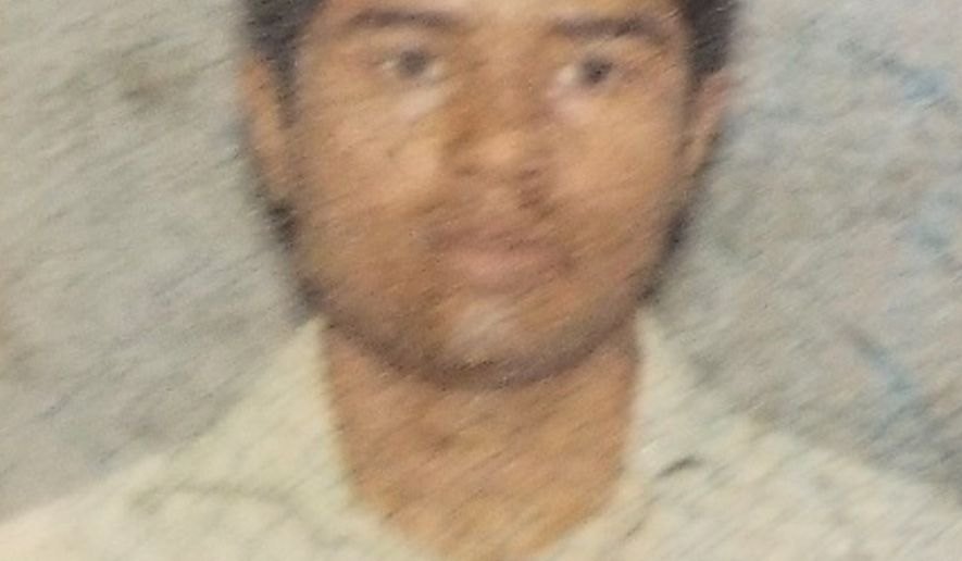 This photo from a 2011 drivers license shows Akayed Ullah, the suspect in the explosion near New York's Times Square on Monday, Dec. 11, 2017. Ullah is suspected of strapping a pipe bomb to his body and setting off the crude device under 42nd Street between Seventh and Eighth Avenues, injuring himself and a few others. (New York Department of Motor Vehicles via AP)