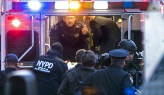 Officials place suspect Akayed Ullah, on a stretcher, into the back of an ambulance on Eighth Avenue between 42nd Street and 43rd Street, Monday, Dec. 11, 2017, in New York. Ullah is suspected of strapping a pipe bomb to his body and setting off the crude device in a passageway under 42nd Street between Seventh and Eighth Avenues, injuring himself and a few others. (Craig Ruttle/Newsday via AP)