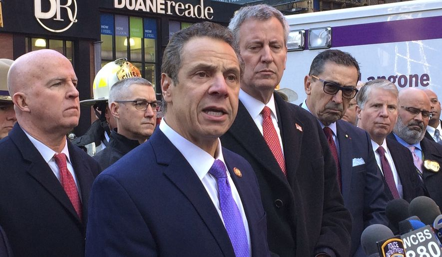 New York Gov. Andrew Cuomo speaks to members of the media after a pipe bomb strapped to a man went off in a New York City subway near Times Square on Monday, Dec. 11, 2017, in New York. Mayor Bill de Blasio stands fourth from left. (AP Photo/Mark Lennihan)