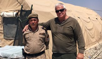Tom Kelly and Peshmerga officer at a domed shelter hospital in Iraq. (Photo from Tom Kelly)