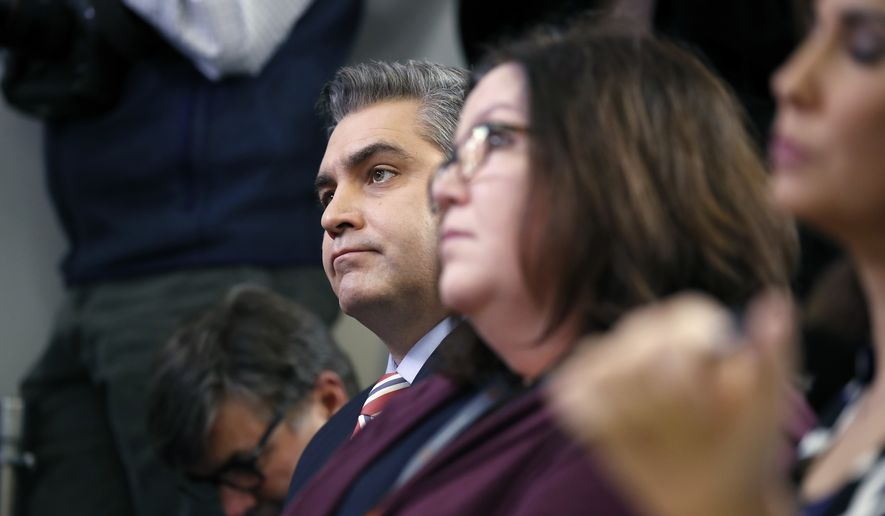 CNN's Jim Acosta, left, listens to White House press secretary Sarah Huckabee Sanders during a press briefing at the White House, Monday, Dec. 11, 2017, in Washington. (AP Photo/Alex Brandon) **FILE**