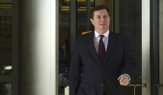 Former Trump campaign chairman Paul Manafort departs federal court in Washington, Monday, Dec. 11, 2017. (AP Photo/Susan Walsh) ** FILE **
