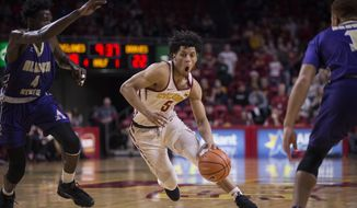 Iowa State's Lindell Wigginton, center, brings the ball downcourt during an NCAA college basketball game against Alcorn State, Sunday, Dec. 10, 2017, in Ames Iowa. (Kelsey Kremer/The Des Moines Register via AP)