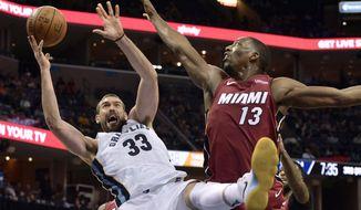 Memphis Grizzlies center Marc Gasol (33) shoots against Miami Heat center Bam Adebayo (13) in the second half of an NBA basketball game Monday, Dec. 11, 2017, in Memphis, Tenn. (AP Photo/Brandon Dill)