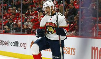 Florida Panthers center Vincent Trocheck (21) celebrates his goal against the Detroit Red Wings in the third period of an NHL hockey game Monday, Dec. 11, 2017, in Detroit. (AP Photo/Paul Sancya)