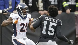FILE - In this Nov. 26, 2017, file photo, Denver Broncos cornerback Aqib Talib (21) fights Oakland Raiders wide receiver Michael Crabtree (15) during the first half of an NFL football game in Oakland, Calif. Sometimes, it seems, conflicts between cornerbacks and wideouts are simply unavoidable.  It is a unique dynamic in NFL games week after week: On play after play, CBs and WRs match up 1-on-1, with plenty of grabbing and shoving and, yes, yapping mixed in. (AP Photo/Ben Margot, File) **FILE**