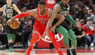 Boston Celtics' Jaylen Brown, right, pressures Chicago Bulls' David Nwaba during the first half of an NBA basketball game Monday, Dec. 11, 2017, in Chicago. (AP Photo/Charles Rex Arbogast)