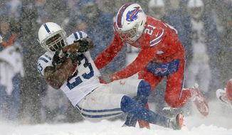 Buffalo Bills free safety Jordan Poyer, right, tackles Indianapolis Colts running back Frank Gore during the second half of an NFL football game, Sunday, Dec. 10, 2017, in Orchard Park, N.Y. (AP Photo/Adrian Kraus)