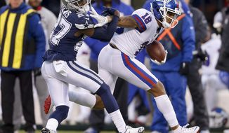 New York Giants wide receiver Roger Lewis (18) tries to avoid Dallas Cowboys cornerback Jourdan Lewis (27) during the fourth quarter of an NFL football game, Sunday, Dec. 10, 2017, in East Rutherford, N.J. The Cowboys won 30-10. (AP Photo/Adam Hunger)