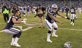 Dallas Cowboys quarterback Dak Prescott (4) celebrates after beating the New York Giants 30-10 in an NFL football game, Sunday, Dec. 10, 2017, in East Rutherford, N.J. (AP Photo/Bill Kostroun)