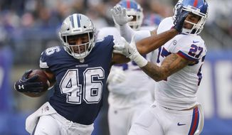 Dallas Cowboys running back Alfred Morris (46) stiff-arms New York Giants free safety Darian Thompson (27) during the fourth quarter of an NFL football game, Sunday, Dec. 10, 2017, in East Rutherford, N.J. (AP Photo/Adam Hunger)