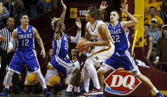 Minnesota center Reggie Lynch (22) tries to get between Drake guard Ore Arogundade (23) and forward Casey Schlatter (22) as forward Antonio Pilipovic (11) watches in the first half of an NCAA college basketball game Monday, Dec. 11, 2017, in Minneapolis. (AP Photo/Bruce Kluckhohn)