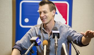 Milwaukee Brewers Manager Craig Counsell talks with media representatives during the Major League Baseball winter meetings in Orlando, Fla., Monday, Dec. 11, 2017. (AP Photo/Willie J. Allen Jr.)