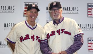 Newly elected Hall of Famers Alan Trammell, left, and Jack Morris, right, pose for photos in their new Hall of Fame jerseys during the Major League Baseball winter meetings in Orlando, Fla., Monday, Dec. 11, 2017. (AP Photo/Willie J. Allen Jr.)
