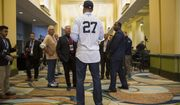 Newest Yankee Giancarlo Stanton answers questions for members of the media during the Major League Baseball winter meetings in Orlando, Fla., Monday, Dec. 11, 2017. (AP Photo/Willie J. Allen Jr.)