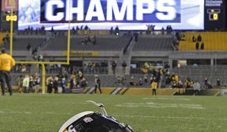 The helmet of Pittsburgh Steelers inside linebacker Ryan Shazier (50) sits on the field after an NFL football game between the Pittsburgh Steelers and the Baltimore Ravens in Pittsburgh, Monday, Dec. 11, 2017. The Steelers won one for injured star Shazier and wrapped up the AFC North in the process. The Steelers beat the Baltimore Ravens 39-38 to capture the AFC North Championship. (AP Photo/Don Wright)