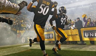Pittsburgh Steelers defensive end Cameron Heyward (97) takes the field holding the jersey of teammate Ryan Shazier (50) during introductions before an NFL football game against the Baltimore Ravens in Pittsburgh, Sunday, Dec. 10, 2017. (AP Photo/Keith Srakocic)