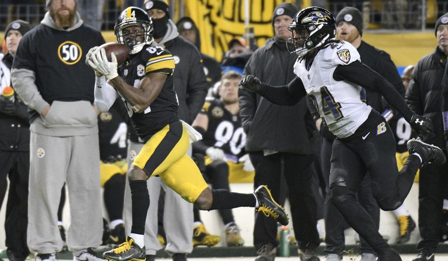Pittsburgh Steelers wide receiver Antonio Brown (84) hauls in a pass from quarterback Ben Roethlisberger with Baltimore Ravens cornerback Brandon Carr (24) defending during the second half of an NFL football game in Pittsburgh, Sunday, Dec. 10, 2017. The play set up the game-winning field goal. The Steelers won 39-38. (AP Photo/Don Wright)