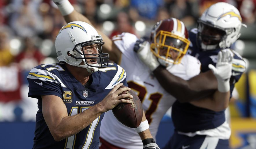 Los Angeles Chargers quarterback Philip Rivers scrambles during the first half of an NFL football game against the Washington Redskins, Sunday, Dec. 10, 2017, in Carson, Calif. (AP Photo/Alex Gallardo)