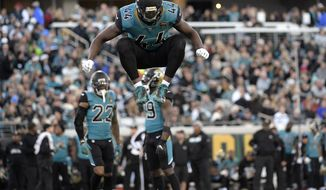 Jacksonville Jaguars linebacker Myles Jack (44) celebrates a play against the Seattle Seahawks during the first half of an NFL football game, Sunday, Dec. 10, 2017, in Jacksonville, Fla. (AP Photo/Phelan M. Ebenhack)