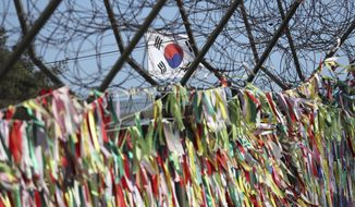 South Korea's national flag flutters in the wind at the Imjingak Pavilion in Paju, South Korea, Monday, Dec. 11, 2017. South Korea added several North Korean groups and individuals to its sanctions list Monday in a largely symbolic move that is part of efforts to cut off funding for the North's weapons programs. (AP Photo/Lee Jin-man)