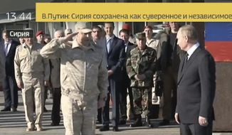 In this Monday, Dec. 11, 2017 frame grab made available by Russian Rossiya 24 TV Channel Sergei Surovikin, Russian Commander in Syria, 3rd left, reports to President Vladimir Putin, right, as Syrian President Bashar Assad, 4th left, listens, at the Hemeimeem air base in Syria. Declaring a victory in Syria, Putin on Monday visited a Russian military air base in the country and announced a partial pullout of Russian forces from the Mideast nation (Rossiya 24 TV Channel photo via AP)