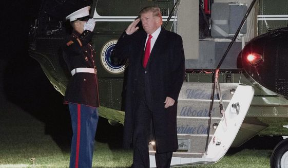 President Donald Trump steps off Marine One on the South Lawn of the White House in Washington, Sunday, Dec. 10, 2017. Trump is returning from a trip to his Mar-a-Lago estate in Palm Beach, Fla. (AP Photo/Andrew Harnik)