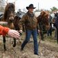 lead in Republican Senate candidate Roy Moore walks his horse after voting in the Alabama senatorial election, Tuesday, Dec. 12, 2017, in Gallant, Ala. (AP Photo/Brynn Anderson) (credit)