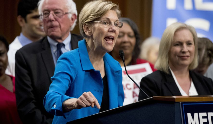 Sen. Elizabeth Warren, D-Mass., center, accompanied by Sen. Bernie Sanders, I-Vt., left, and Sen. Kirsten Gillibrand, D-N.Y., right, speaks during a news conference on Capitol Hill in Washington, Wednesday, Sept. 13, 2017, to unveil their Medicare for All legislation to reform health care. (AP Photo/Andrew Harnik) **FILE**