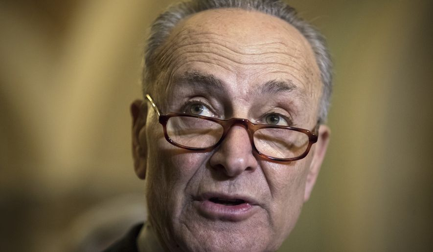 Senate Minority Leader Chuck Schumer, D-N.Y., speaks to reporters about the GOP tax bill following the Democratic Caucus weekly policy meeting, on Capitol Hill in Washington, Tuesday, Dec. 12, 2017. (AP Photo/J. Scott Applewhite)