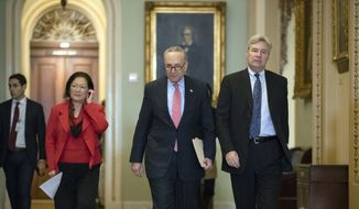 Senate Minority Leader Chuck Schumer, D-N.Y., flanked by Sen. Mazie Hirono, D-Hawaii, and Sen. Sheldon Whitehouse, D-R.I., walks to a news conference following a closed-door policy meeting, on Capitol Hill in Washington, Tuesday, Dec. 12, 2017. (AP Photo/J. Scott Applewhite) ** FILE **