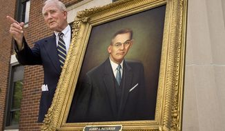FILE - In this June 16, 2006 file photo, former Alabama Gov. John Patterson reacts to a question about the portrait of his father Albert Patterson, which was unveiled at a ceremony on the front steps of the Russell County Courthouse in Phenix City, Ala. Patterson, a lawyer who fought to eradicate a crime syndicate blamed for illegal gambling, prostitution and other crimes in Phenix City, was assassinated outside his office shortly after winning the Democratic nomination for state attorney general in 1954. Patterson's son John Patterson assumed the nomination and won; a sheriff's deputy was convicted in the slaying. (Roger Hart/Ledger-Enquirer via AP, File)