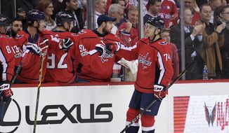 Washington Capitals defenseman John Carlson (74) celebrates his goal during the second period of an NHL hockey game against the Colorado Avalanche, Tuesday, Dec. 12, 2017, in Washington. (AP Photo/Nick Wass) **FILE**