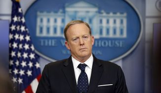 In this June 20, 2017, file photo, White House press secretary Sean Spicer listens to a reporter's question during a briefing at the White House in Washington. (AP Photo/Alex Brandon, File)