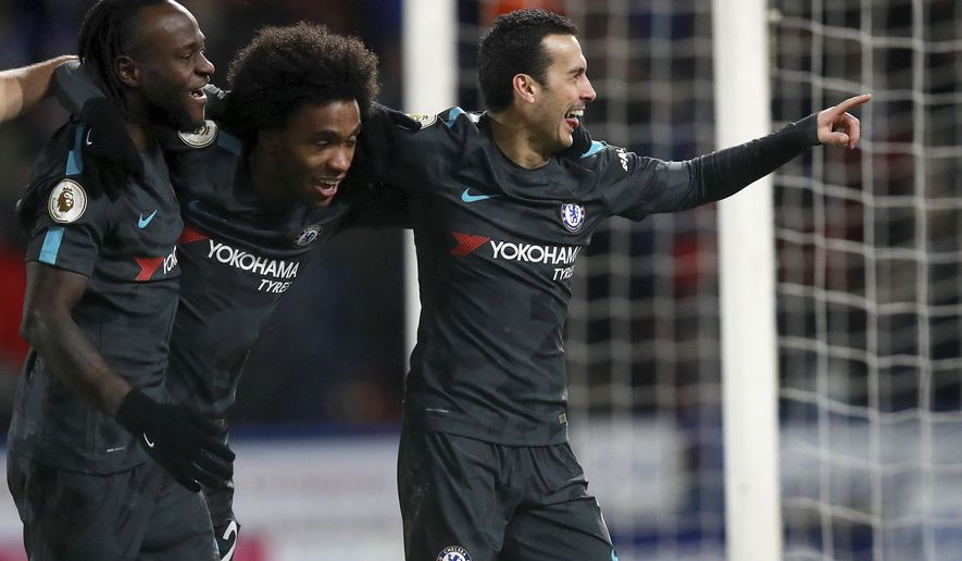Chelsea's Rodriguez Pedro, right, celebrates scoring his sides third goal during their English Premier League soccer match against Huddersfield at the John Smith's Stadium, Huddersfield, England, Tuesday, Dec. 12, 2017. (Mike Egerton/PA via AP)