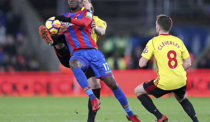 Crystal Palace's Christian Benteke, left, and Watford's Sebastian Prodl challenge for the ball  during the English Premier League match Crystal Palace versus Watford at Selhurst Park, London, Tuesday Dec. 12, 2017. (Adam Davy/PA via AP)