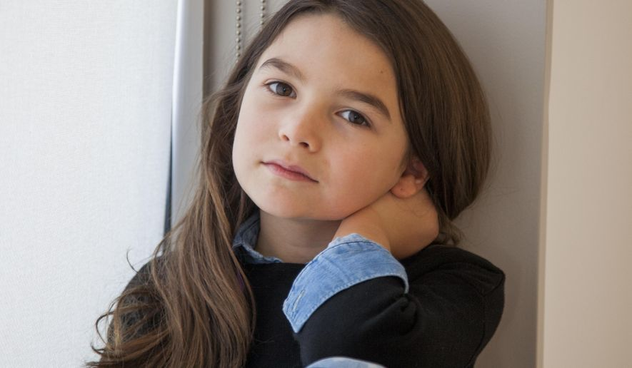 """In this Nov. 28, 2017 photo, actress Brooklynn Prince poses for a portrait in New York to promote her film, """"The Florida Project."""" Her performance as Moonee, a brash, troublemaking pipsqueak living with her mom (Bria Vinaite) in a low-rent Orlando motel, may be the most spirited thing of 2017. (Photo by Andy Kropa/Invision/AP)"""