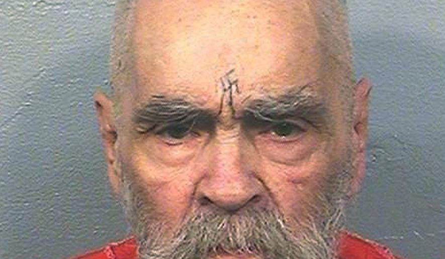 FILE - This Aug. 14, 2017 file photo provided by the California Department of Corrections and Rehabilitation shows Charles Manson. Manson died of cardiac arrest accompanied by respiratory failure, triggered by colon cancer that had spread to other areas of his body. The deadly cult leader's death certificate confirms that he died Nov. 19, 2017, at Bakersfield's Mercy Hospital, near where the 83-year-old had been serving a life sentence for orchestrating the 1969 killings of pregnant actress Sharon Tate and eight other people. (California Department of Corrections and Rehabilitation via AP, File)