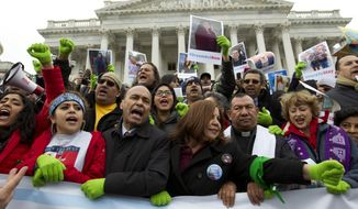 In this Dec. 6, 2017 photo, Rep. Luis Gutierrez D-Ill., third from left, along with other demonstrators protest outside of the U.S. Capitol in support of the Deferred Action for Childhood Arrivals (DACA), and Temporary Protected Status (TPS), programs, during an rally on Capitol Hill in Washington.  House and Senate Democrats stand divided over whether to fight now or later about the fate of some 800,000 young immigrants who came to the U.S. illegally as children. ( AP Photo/Jose Luis Magana) **FILE**