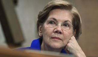 In this Dec. 5, 2017, file photo, Sen. Elizabeth Warren, D-Mass., waits to speak during a meeting of the Senate Banking Committee on Capitol Hill in Washington. (AP Photo/Susan Walsh, File)