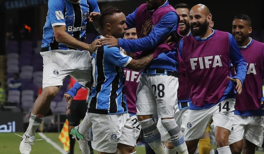Brazil's Gremio Everton, center, celebrates with his teammates after scoring the opening goal during the Club World Cup semifinal soccer match between Gremio and Pachuca at the Hazza Bin Zayed stadium in Al Ain, United Arab Emirates, Tuesday, Dec. 12, 2017. (AP Photo/Hassan Ammar)