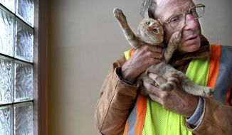 "In this Nov. 15, 2017, photo, Chuck Nehls cuddles with his new kitten in St. Paul, Minn. Community members donated over $2,500 to get Nehls a new kitten -- along with bags of donated food and litter, and any future veterinary procedures covered -- after his cat, Ashley, died in April after 17 years of being Nehls' ""best friend."" (Jean Pieri/Pioneer Press via AP)"