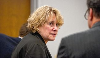 In a Sept. 6, 2017 photo, Christina Fey of Wolfeboro appears in District Court at the Carroll County Superior Courthouse in Ossipee, N.H. Fay,  who had dozens of filthy and sick Great Danes living in her New Hampshire mansion was found guilty Tuesday, Dec. 12, 2017, of 10 animal cruelty charges.  (Elizabeth Frantz/The Concord Monitor via AP)