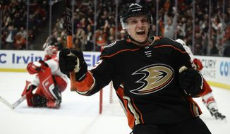 Anaheim Ducks right wing Jakob Silfverberg celebrates after scoring past Carolina Hurricanes goalie Scott Darling during the second period of an NHL hockey game in Anaheim, Calif., Monday, Dec. 11, 2017. (AP Photo/Chris Carlson)