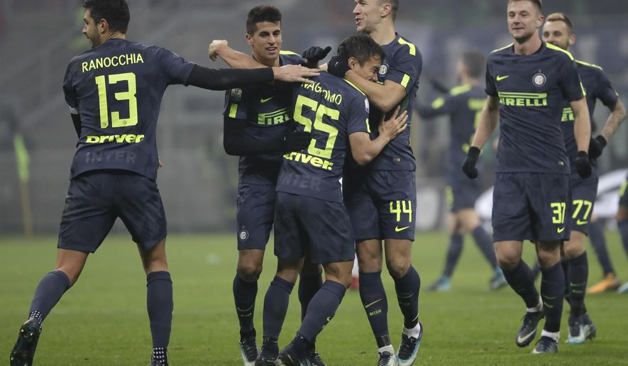 Inter Milan's Yuto Nagatomo, center, celebrates with teammates Joao Cancelo, Ivan Perisic and Andrea Ranocchia after scoring the decisive penalty during the Italian Cup soccer match between Inter Milan and Pordenone at the San Siro stadium in Milan, Italy, Tuesday, Dec.12, 2017. InInter won 5-4 following a shootout.  (AP Photo/Luca Bruno)