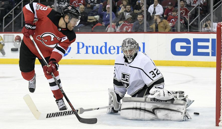 New Jersey Devils left wing Taylor Hall (9) scores a goal past Los Angeles Kings goalie Jonathan Quick (32) during the second period of an NHL hockey game Tuesday, Dec.12, 2017, in Newark, N.J. (AP Photo/Bill Kostroun)